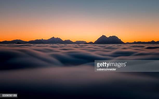Austria, Mountain peaks above clouds as seen from Gaisberg near Salzburg