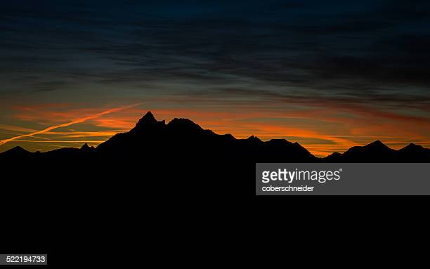 austria, mountain silhouettes after sunset - after stock photos and pictures