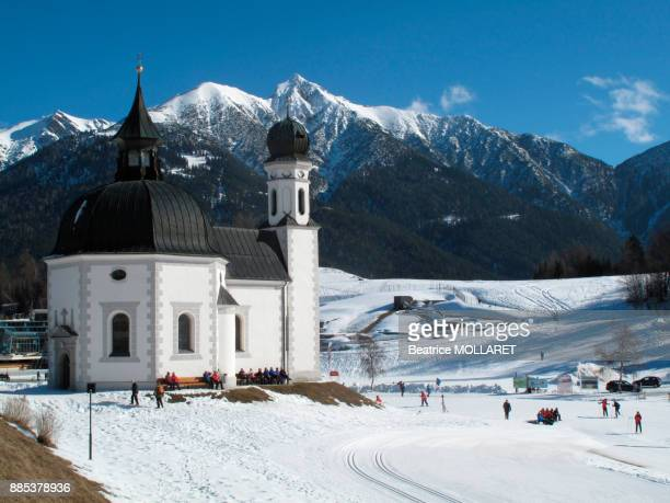 Austria, North Tirol, Seefeld, the Seekirchl chapel on the cross-country skiing station of Seefeld in the background the snow-capped mountains of the Karwendel