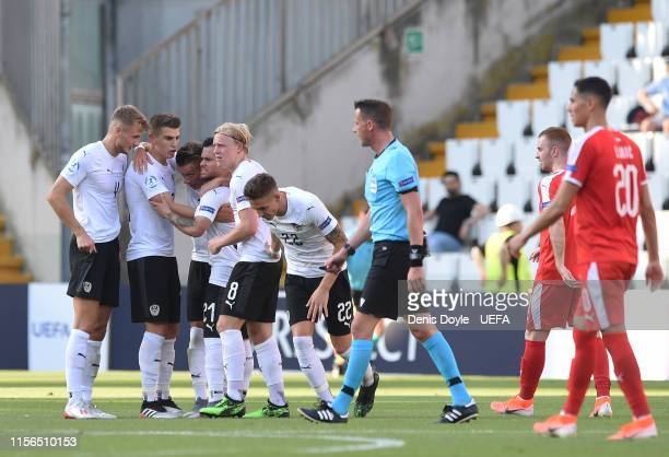 Austria players celebrate after a VAR decision overturned a previous offside decision to allow Austria's opening goal during the 2019 UEFA U-21 Group...