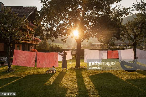austria, radstadt, farm, female farmer hangs the washing on the line - farmhouse stock pictures, royalty-free photos & images