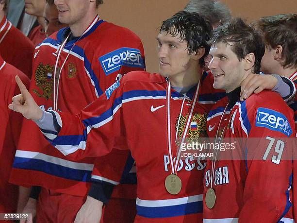 Russian players Alexander Ovechkin and Alexei Yashin pose with their bronze medal at the end of the IIHF Men's World Championship match for the third...