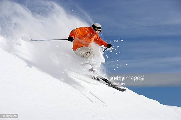 Austria, Saalbach, male skier jumping on slope