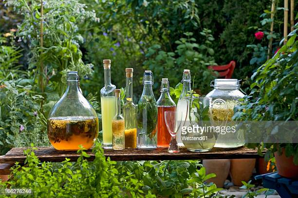 Austria, Salzbuger Land, Variety of bottles and carafes with vinegar and oil placed on side table