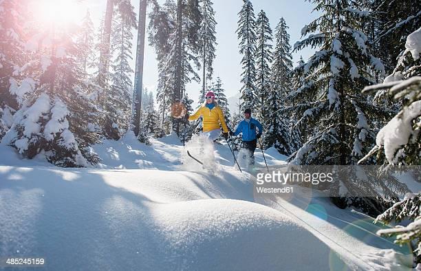 Austria, Salzburg Country, Altenmarkt-Zauchensee, Young couple cross-country skiing