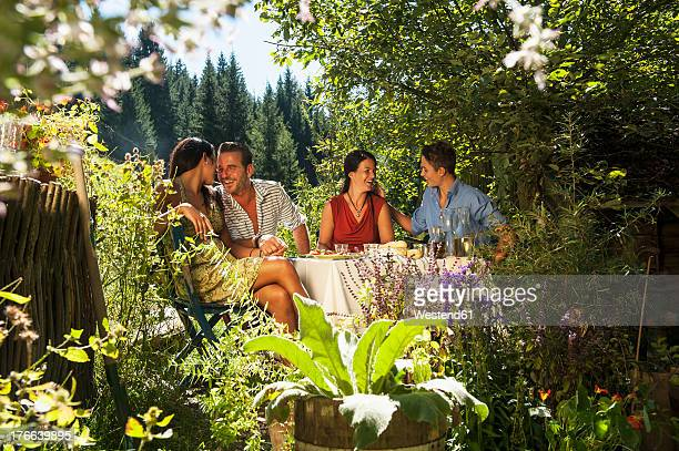 Austria, Salzburg Country, Family chating in garden