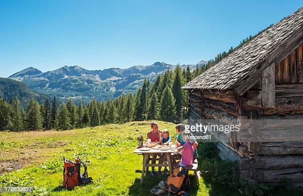 Austria, Salzburg Country, Family having rest at Altenmarkt Zauchensee