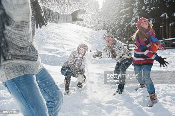 Austria, Salzburg Country, Flachau, Young people snow fighting in snow