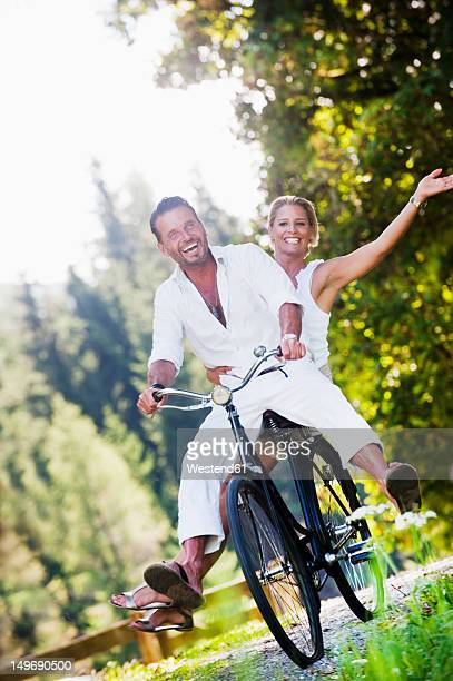 Austria, Salzburg County, Couple riding bicycle
