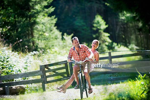 austria, salzburg county, couple riding bicycle - 7894 stock pictures, royalty-free photos & images