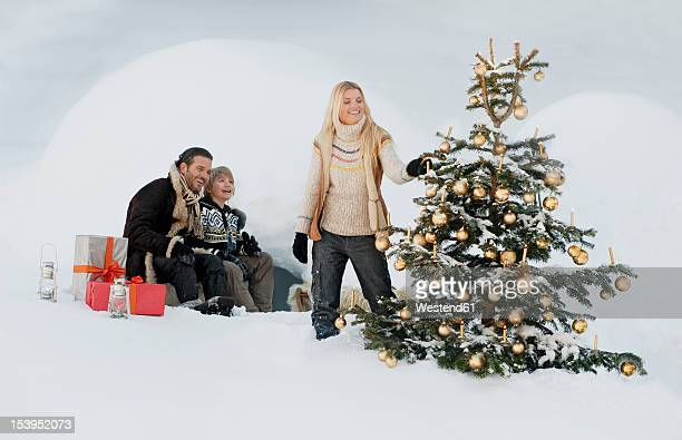 Austria, Salzburg County, Family celebrating christmas in snow