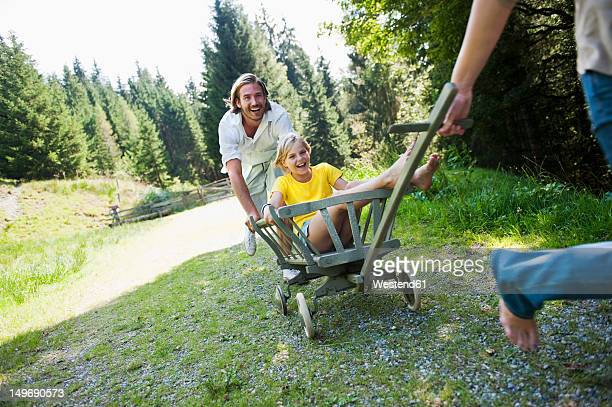 Austria, Salzburg County , Family with rack wagon