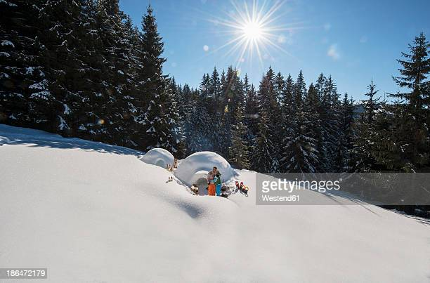Austria, Salzburg, Couple standing in front of igloo
