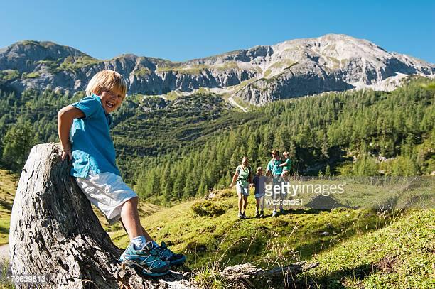 Austria, Salzburg, Family walking on mountains at Altenmarkt Zauchensee