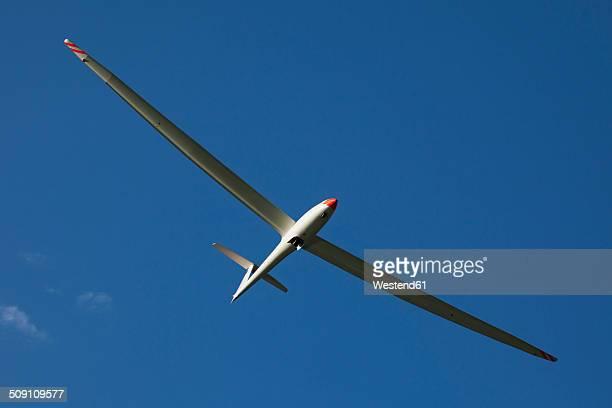 Austria, Salzburg, glider in front of blue sky