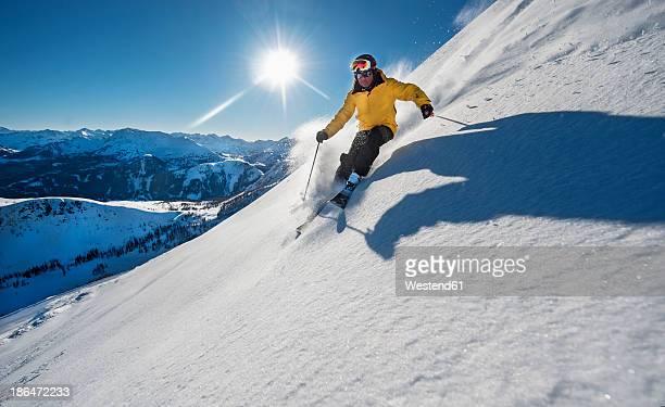 Austria, Salzburg, Mature man skiing in mountain of Altenmarkt Zauchensee