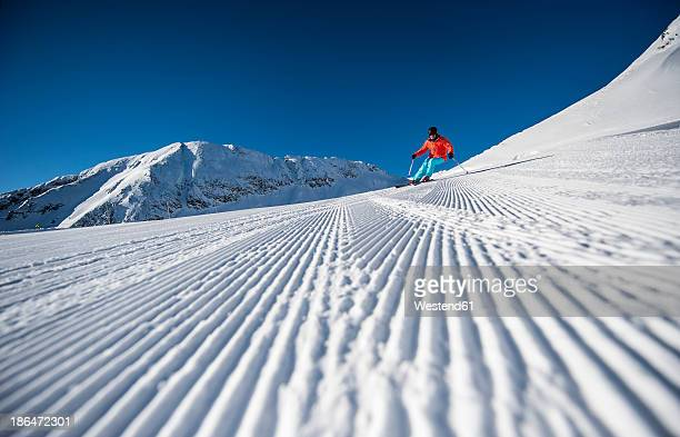 Austria, Salzburg, Mid adult man skiing in mountain of Altenmarkt Zauchensee