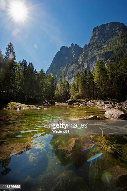 Austria, Salzburg, Mid adult woman swimming in lake near gosau