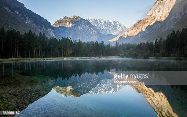 Austria, Salzburg, Mountains reflecting in mountain lake