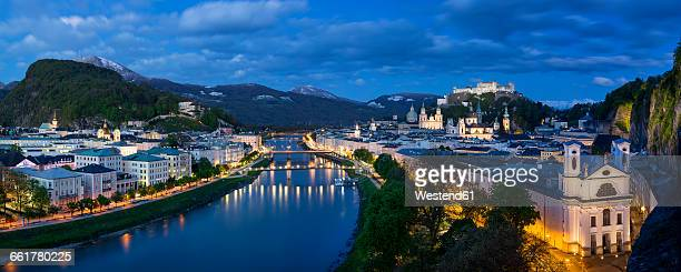 Austria, Salzburg, panoramic view of Salzach river, old town and castle Hohensalzburg, blue hour