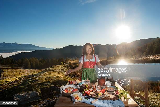 Austria, Salzburg State, Altenmarkt-Zauchensee, alpine pasture, breakfast at sunrise