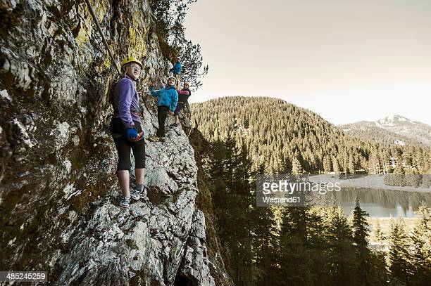 Austria, Salzburg State, Altenmarkt-Zauchensee, family at via ferrata