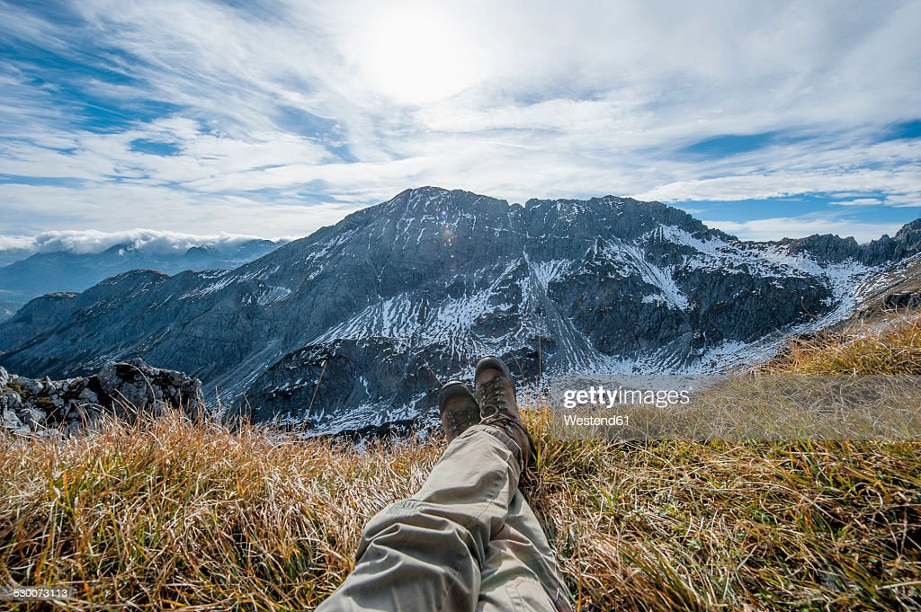 Austria, Salzburg State, Altenmarkt-Zauchensee, man's legs in front of snow-capped cirque : Stock Photo