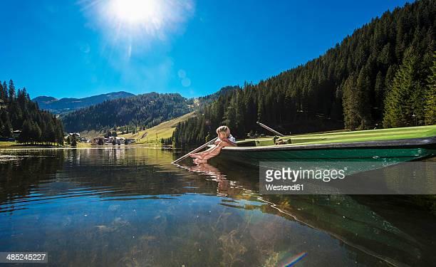 Austria, Salzburg State, Altenmarkt-Zauchensee, woman and boy in a boat