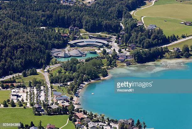 Austria, Salzburg State, Salzkammergut, Fuschl am See, View to Seaside Resort and Red Bull Headquarter at Lake Fuschlsee