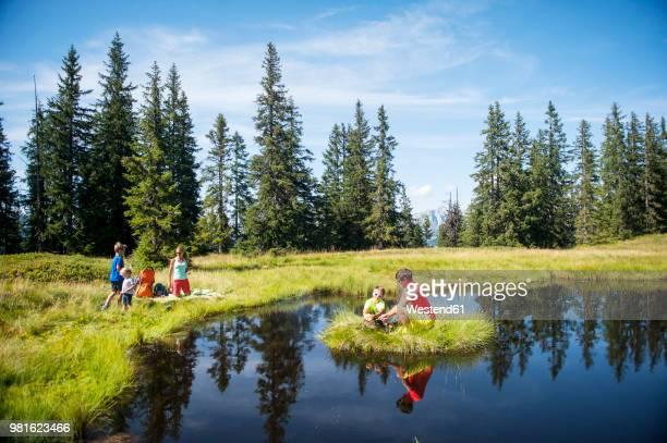 Austria, Salzburg State, Untertauern, family resting on a lake
