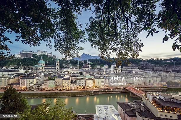 Austria, Salzburg, View of the city on Salzach river with Hohensalzburg castle in background