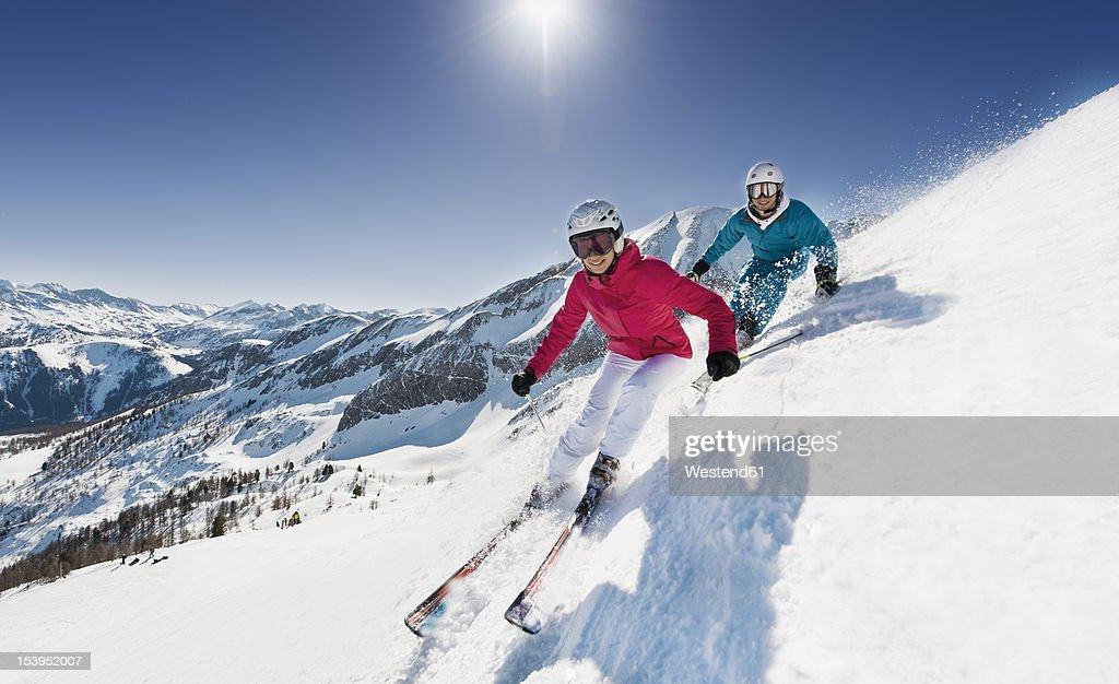 Austria, Salzburg, Young couple skiing on mountain : Photo
