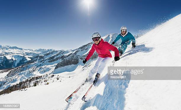 austria, salzburg, young couple skiing on mountain - austria stock pictures, royalty-free photos & images