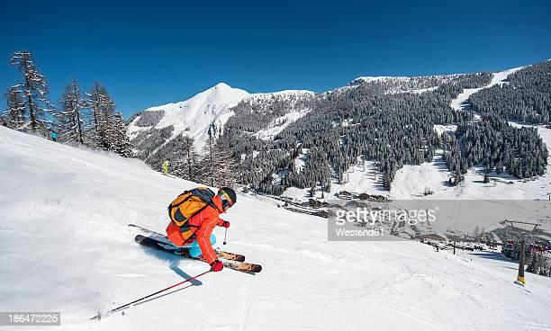 Austria, Salzburg, Young man skiing in mountain of Altenmarkt Zauchensee