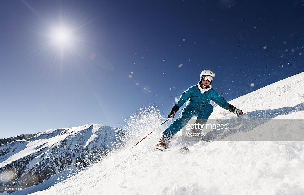 Austria, Salzburg, Young man skiing on mountain : Stock Photo