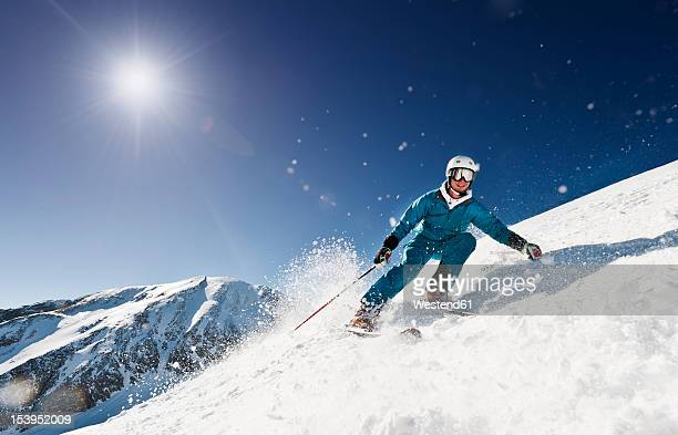 Austria, Salzburg, Young man skiing on mountain