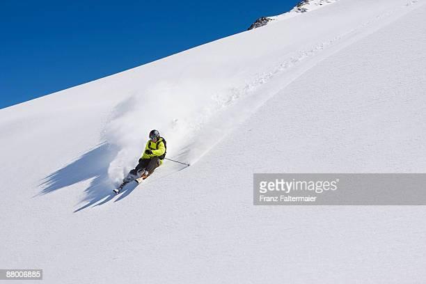austria, salzburger land, kaprun, freeride, man skiing downhill - downhill skiing stock pictures, royalty-free photos & images