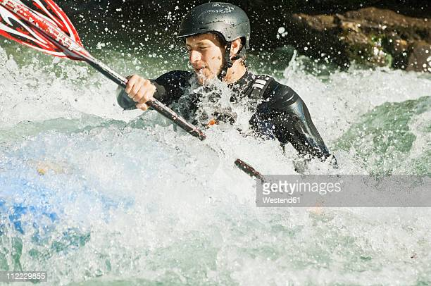 Austria, Salzburger Land, Man kayaking in lammer river