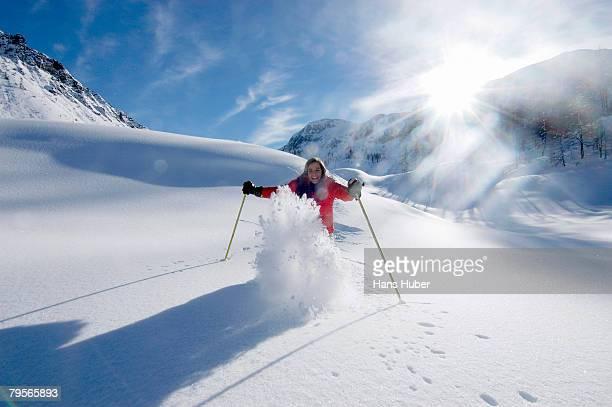 Austria, Salzburger Land, woman skiing in mountains
