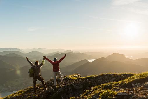 Austria, Salzkammergut, Cheering couple reaching mountain summit - gettyimageskorea