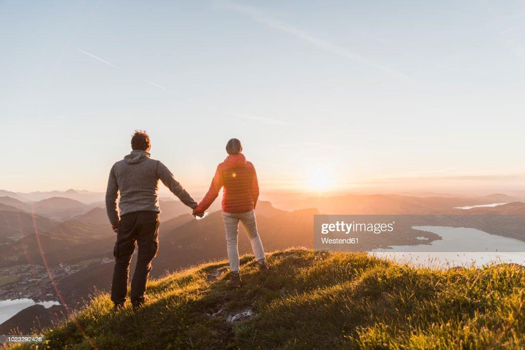 Austria, Salzkammergut, Couple standing on mountain summit, enjoying the view : Stock Photo