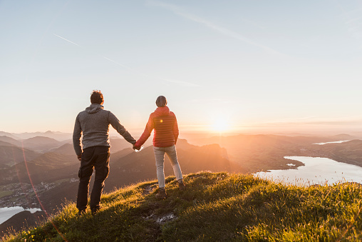 Austria, Salzkammergut, Couple standing on mountain summit, enjoying the view - gettyimageskorea