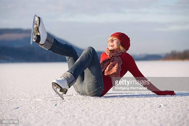 Austria, Salzkammergut, Lake Irrsee, Female teenagers (14-15) skating