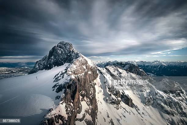 Austria, Schladming, Dachstein Mountains with south face of Hunerkogel in the foreground