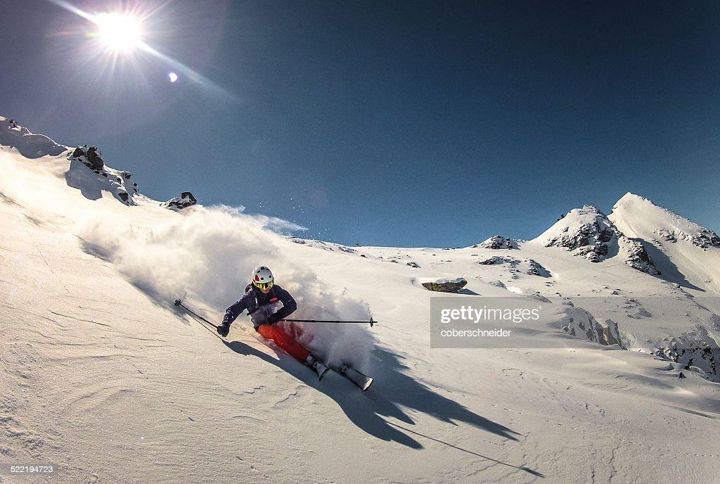 Austria, Skier doing turn in fresh powder snow : Stock Photo