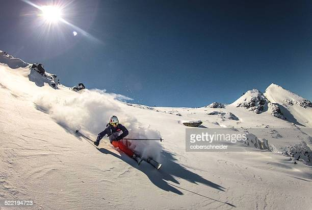 Austria, Skier doing turn in fresh powder snow
