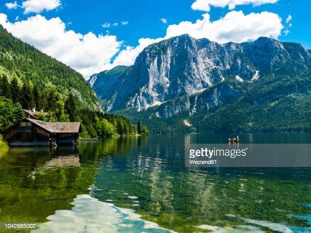 austria, styria, altaussee, boathouse at altausseer see with trisselwand at in the background - estiria austria fotografías e imágenes de stock