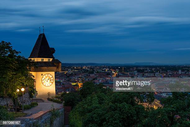 austria, styria, graz, clock tower with panoramic view in the evening - graz stock photos and pictures