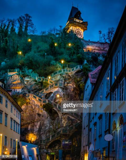 austria, styria, graz, grazer schlossberg, castle mountain with staircase, clock tower at night - graz stock photos and pictures