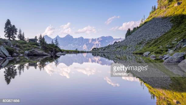 austria, styria, liezen district, tauern, view to dachstein, lake spiegelsee - reflection lake stock photos and pictures